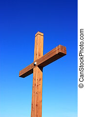 View of a wooden cross against blue sky.
