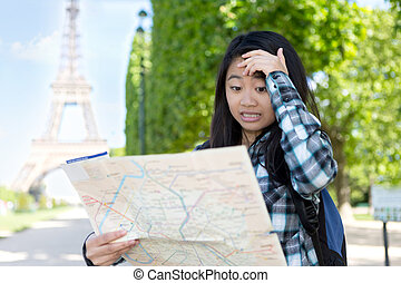 Young attractive asian tourist lost in Paris