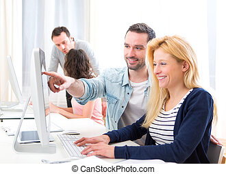 Young attractive people taking a training course - View of a...