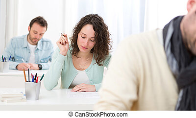Young attractive student taking exams - View of a Young...