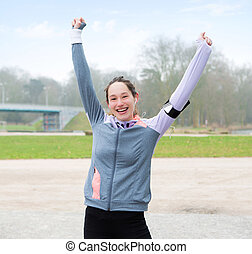 Young attractive woman just finishing a running session