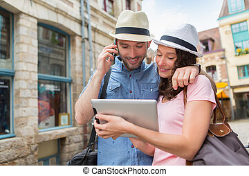 Young couple of tourists booking hostel - View of a Young...