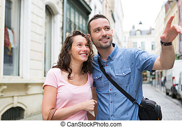 Young couple on holidays doing shopping