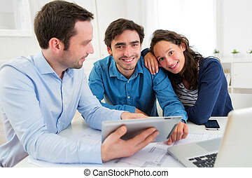 young serious couple meeting a real estate agent