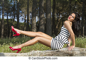 young woman in a black and white tight and short dress...