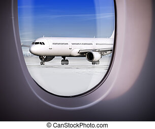 view of airport through window - view of plane on runway...