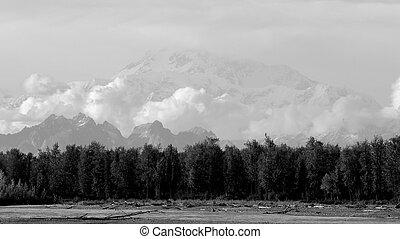 View of Alaska range from river in Talkeetna
