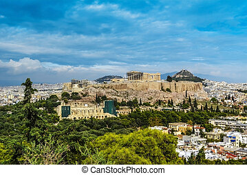 View of an acropolis, amphitheater and the mountain Lycabettus in Athens from the hill