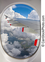 View of an airplane wing out the window