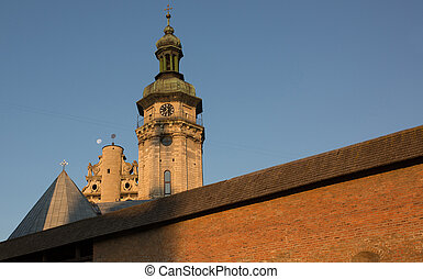 View of an old church with a monastery in Lviv at sunrise