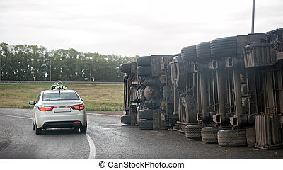 view of an overturned truck on highway in accident.