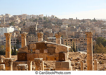 View of ancient Roman ruins and houses in the background