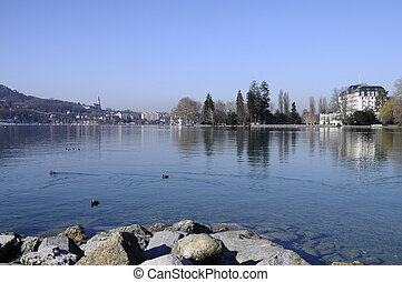 View of Annecy town, casino of annecy and lake on morning