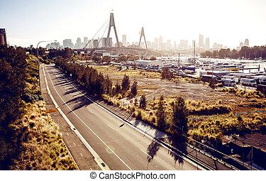 View of Anzac Bridge and buildings in Sydney, Australia.