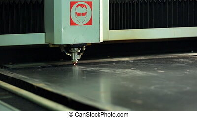 View of automated machine laser cutting metal, close-up