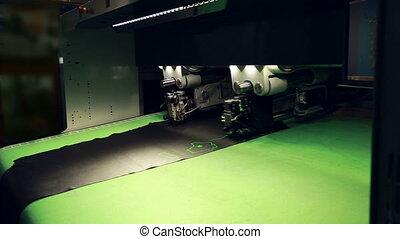Automatic machine cuts pelt on parts. Footwear production