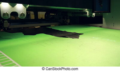 View of automatic machine cutting pelt for parts, close-up