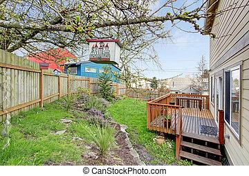 View of backyard walkout deck