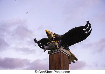 View of bald eagle wood sculpture in Port Alberni, Canada