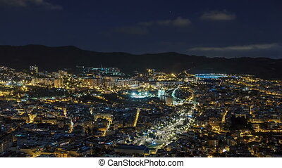 View of Barcelona night timelapse with Square Statute from Bunkers Carmel. Catalonia, Spain.