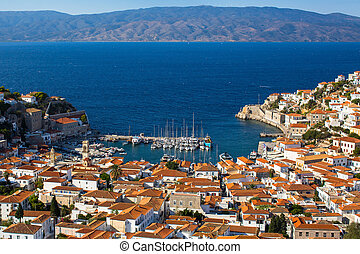 View of bay, yacht marina and living houses on Hydra island, Greece.