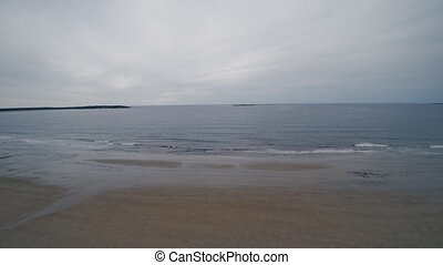 empty sandy beaches of ocean during low tide - View of beach...