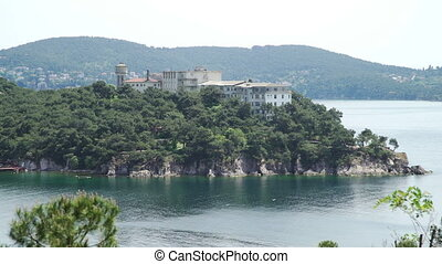 View of big house on sea coast of Island - View of bay of...