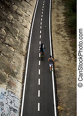 View of bike path in Rome whit two man