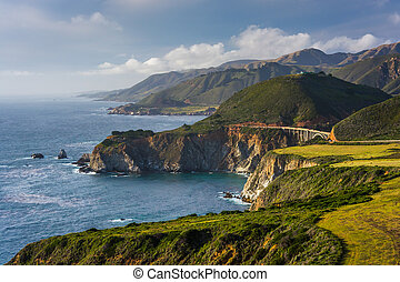 View of Bixby Creek Bridge and mountains along the Pacific Coast, in Big Sur, California.