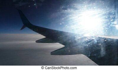 Blurred wing through dirty window