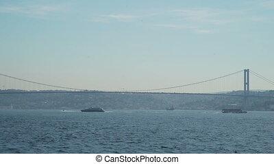 View of Bosphorus Bridge and passengers ships