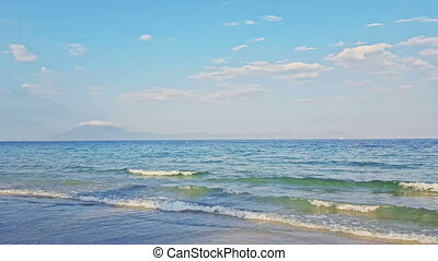 View of Boundless Azure Ocean with Wave Surf against Blue...