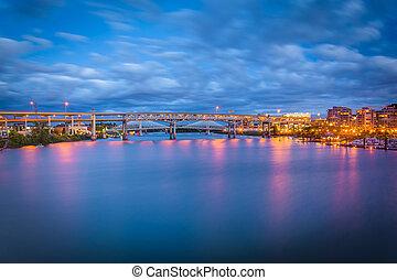 View of bridges over the Williamette River at twilight, in Portland, Oregon.