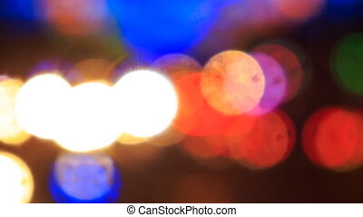 view of bright colourful defocused lights of city illumination