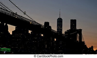 View of Brooklyn Bridge on Manhattan skyline freedom tower by night, New York City USA