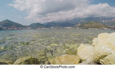 View of Budva from shore of island of St. Nicholas in...