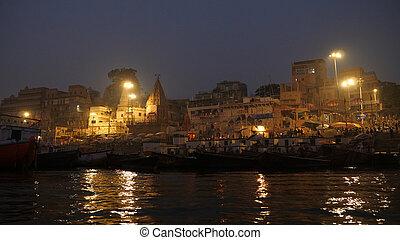 View of buildings of temples with ancient architecture of Varanasi, holy Hindu town, as seen from a moving boat in the late evening. Professional shot in 4K resolution. 024. You can use it e.g. in your commercial video, medical, business, presentation, broadcast