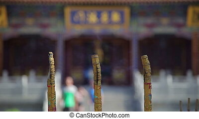 View of Burning Incense Sticks In Chinese Temple