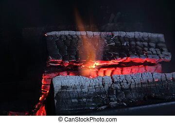 View of burning wood in fire place