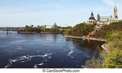 Canada's Parliament Buildings along the Ottawa River - View...