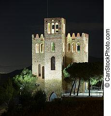 View of Castle Torre Baro in night. Barcelona, Catalonia