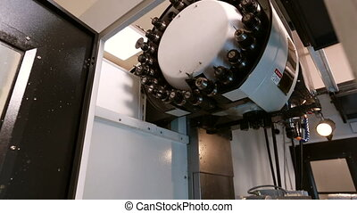 View of changing primary cutter on machine - View of...