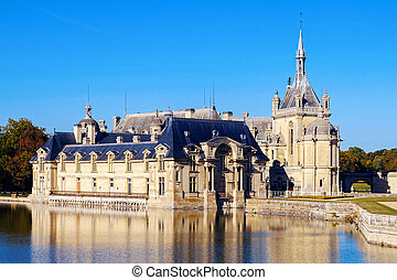 View of Chantilly castle with reflection in water, France