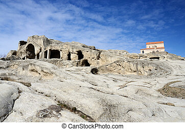 View of christian orthodox church in ancient cave town ...