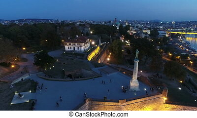 View of city fortress above monument in twilight