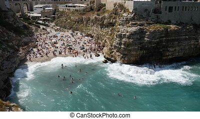 View of cliff and town of Polignano a Mare, Italy - View of...