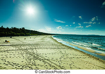View of cloudy sky at sea with footprints on a beach