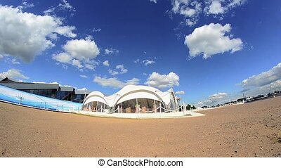 View of coast white spherical cafe on sand beach in sunny summer day.