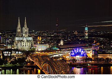 View of Cologne and the Cologne cathedral in the night from height of bird's flight