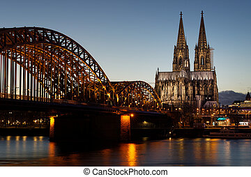 view of cologne over the rhine at dusk